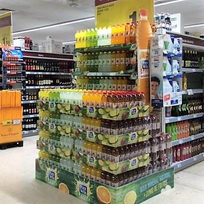 Cabecera lineal supermercado fabricado con polipropileno alveolar, cubrepallet y etiqueteros y corporeos